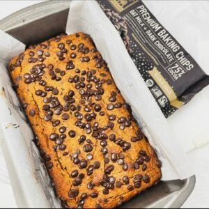 loaf of pumpkin bread with chocolate chips on top fresh out of the oven